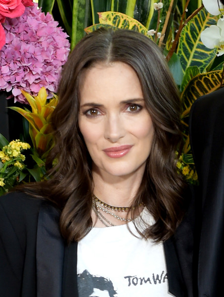 Winona Ryder wore her hair just past her shoulders in a feathery style at the photocall for 'Destination Wedding.'