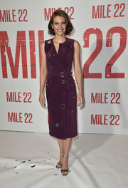 Lauren Cohan looked effortlessly chic in a purple suede wrap dress with oversized grommet detailing at the 'Mile 22' photocall.
