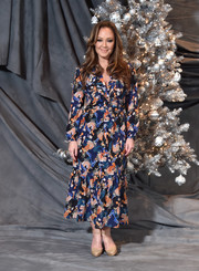 Leah Remini looked lively in a printed midi dress by Saloni at the photocall for 'Second Act.'