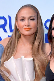 Jennifer Lopez swiped on some orange lipstick for a vibrant beauty look.