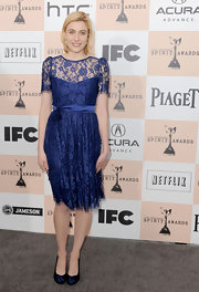 Greta Gerwig completed her vintage-inspired ensemble with a pair of blue round-toe pumps.