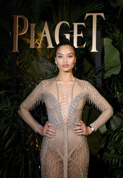 Doutzen Kroes paired a diamond-encrusted watch with a sexy mesh dress for the Piaget dinner during SIHH 2018.