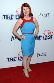 Kate Flannery chose a bright and bold blue and red sleeveless dress for her look at 'The East' premiere.