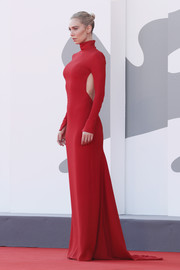 Vanessa Kirby looked alluring in a red Valentino gown with an open back at the Venice Film Festival screening of 'Pieces of a Woman.'