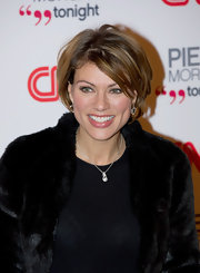 Kate Silverton swiped on a coat of lipgloss to accentuate her perfectly plump lips as she attended the CNN Launch party.
