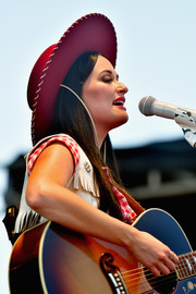Kacey Musgraves performed at the Pilgrimage Music & Cultural Festival wearing a wide-brimmed red hat.