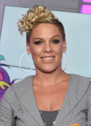 Pink styled her signature mohawk with tight curls for her visit to KISS FM.