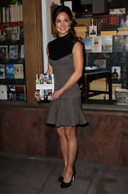Pippa looked sophisticated yet cute in this tweed dress with a fun tulip skirt.