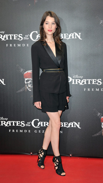 Astrid Berges Frisbey styled her suit with edgy-glam black cage sandals by Jimmy Choo.