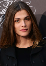 Elisa Sednaoui wore her hair down with a center part during the Pirelli Calendar 50th anniversary press conference.
