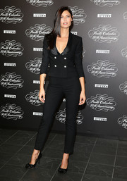Bianca Balti looked cute and sexy in her black Dolce & Gabbana pantsuit at the Pirelli Calendar 50th anniversary press conference.