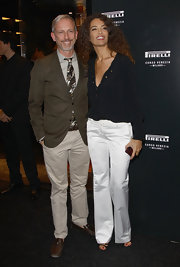 Afef Jnifen sported crisp white wide leg pants at the 'Pirelli Corso Venezia' store opening.