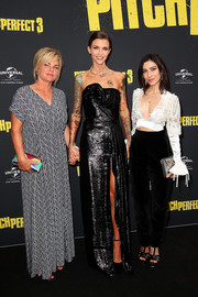 Ruby Rose looked svelte and elegant in a strapless black gown with a sculptural neckline at the Australian premiere of 'Pitch Perfect 3.'