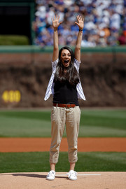 Mila Kunis completed her getup with a pair of white leather sneakers by Puma.