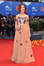 Clara Alonso kept it conservative in a long-sleeve nude tulle gown at the Venice Film Festival premiere of 'Piuma.' The colorful embellishments added a playful touch.