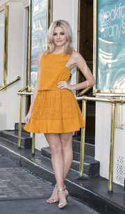 Pixie Lott was a cutie at the 'Breakfast at Tiffany's' photocall in a mustard Fendi mini dress featuring a laser-cut skirt and a bodice overlay that made it look like a two-piece.