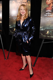 Patricia Clarkson looked sleek and sophisticated in a metallic blue slick trench at 'The Place Beyond the Pines' premiere.