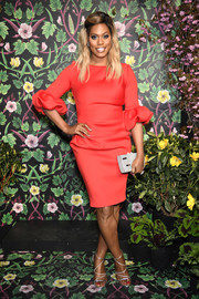 Laverne Cox cut a chic figure in a red Jovani cocktail dress with ruffled sleeves at the 2018 Spring Into Action Gala.