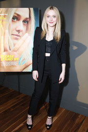 Dakota Fanning teamed a black suit with a lace crop-top for the screening of 'Please Stand By.'