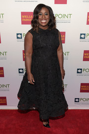 Uzo Aduba kept it timeless in a black lace dress at the Point Honors Gala.