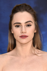 Suki Waterhouse kept it simple with this half-up hairstyle at the premiere of 'Pokemon Detective Pikachu.'