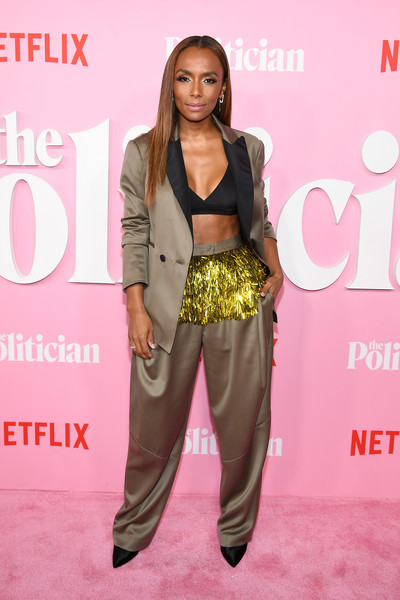 Janet Mock looked festive in a tinsel-embellished taupe pantsuit by Rachel Comey at the premiere of 'The Politician' season 1.
