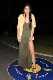 Kendall Jenner attended the Polo Ralph Lauren fashion show looking sexy in a low-cut, high-slit maxi dress.