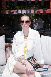 Whitney Port paired a printed shoulder bag with a white duster for an H&M event at Sparrows Lodge.