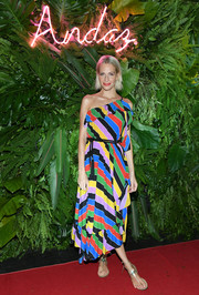 Poppy Delevingne was a delight to behold in this multicolored striped one-shoulder dress by Philosophy di Lorenzo Serafini at the grand opening of Andaz Mayakoba Resort Riviera Maya.