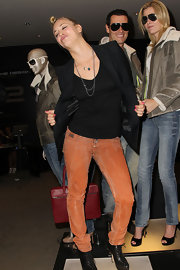 Kaley Cuoco hammed it up in a pair of distressed orange skinny jeans.