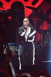 Demi Lovato went sporty in a black-and-white track jacket and matching sweatpants by Marna Ro for her performance at Power 96.1's Jingle Ball 2017.