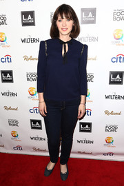Zooey Deschanel kept it modest in a navy tie-neck blouse at the Power of Food event.