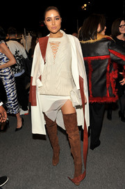 Olivia Culpo punched up her look with brown suede thigh-high boots by Giuseppe Zanotti.