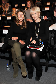 Nina Garcia attended the Prabal Gurung Fall 2011 fashion show wearing tough-looking olive mid-calf boots.