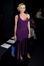 Diane Kruger worked a slinky purple gown with a rust-colored satin underlay at the Prabal Gurung fashion show.