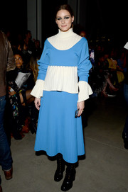Olivia Palermo completed her outfit with a pleated blue skirt, also by Prabal Gurung.