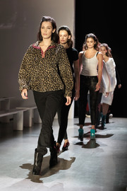 Bella Hadid kept it comfy in a leopard-print sweatshirt and sporty pants while rehearsing for the Prabal Gurung fashion show.