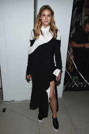 Olivia Palermo sealed off her unique look with black-and-white satin trainers by Kurt Geiger.