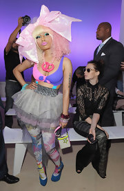 Nicki Minaj attended the Prabal Gurung spring 2012 fashion show wearing an enormous pink hair bow to complement her candy-colored curls.