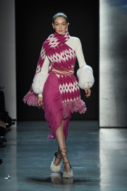 Gigi Hadid sashayed down the Prabal Gurung runway wearing a floaty fuchsia skirt and a white sweater.