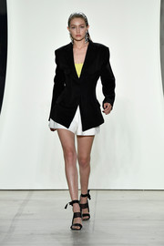 Gigi Hadid looked smart in a bold-shouldered black blazer on the Prabal Gurung runway.