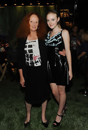 Grace Coddington looked fashionable in a knee-length black skirt with lace hem at Prada 5th Avenue.
