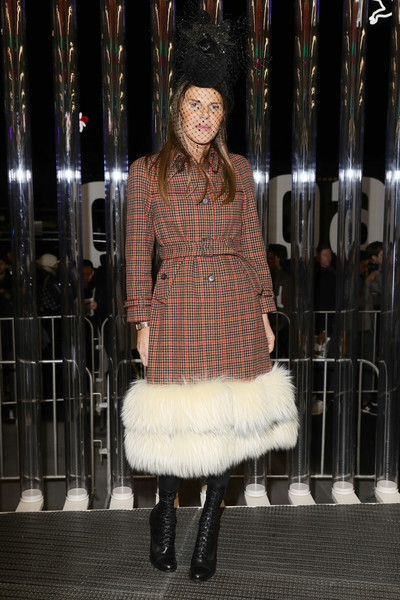 Anna dello Russo was winter-glam in a fur-hem plaid coat by Prada during the brand's Fall 2018 show.