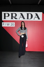 Charli D'Amelio teamed her top with flared black trousers.