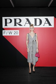 Chiara Ferragni donned a feather-adorned gray wrap dress by Prada for the brand's Fall 2020 show.