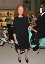 Grace Coddington wore a black dress with a pleated belted skirt to Prada Fashion's Night Out.