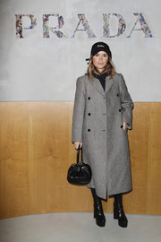 Miroslava Duma arrived for the Prada fashion show wearing a loose gray coat.