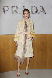 Chiara Ferragni paired her coat with pink satin peep-toe mules.