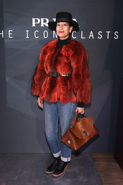 Tracee Ellis Ross was funky-glam in a bright red fur coat teamed with jeans at the Prada Iconoclasts event.