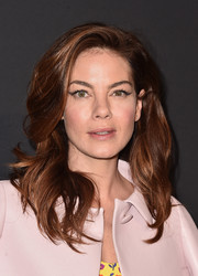 Michelle Monaghan's cat eye makeup added a subtle retro touch.